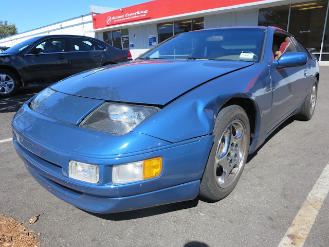 1995 300ZX with dented fender & misaligned hood before repairs at Almost Everything Auto Body