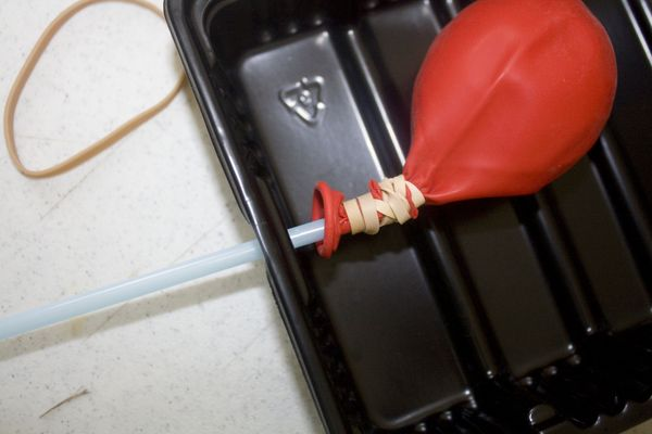 Insert Straw with Balloon inside boat