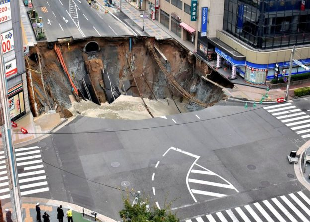 sinkhole swallows street in Fukuoka, Japan