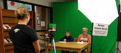 Two 7th grade students using the green screen area.