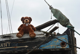 Brown Teddy Bear lookout on The Vigilant at Topsham Quay
