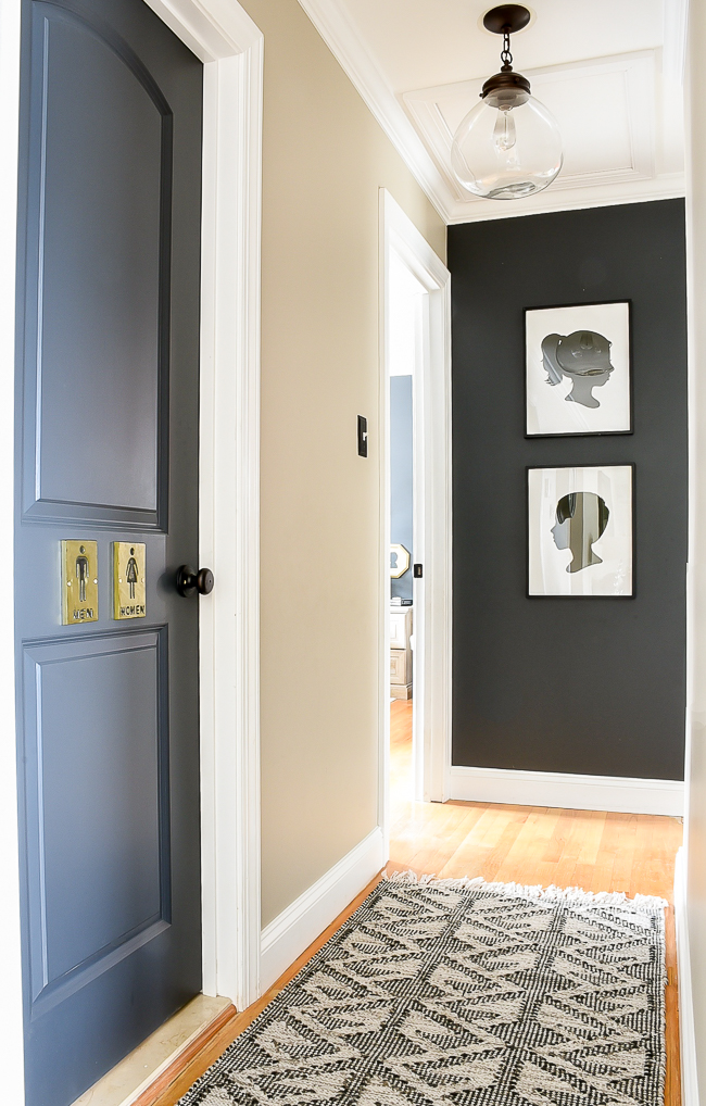 Dark interior doors, dark accent wall and silhouette art