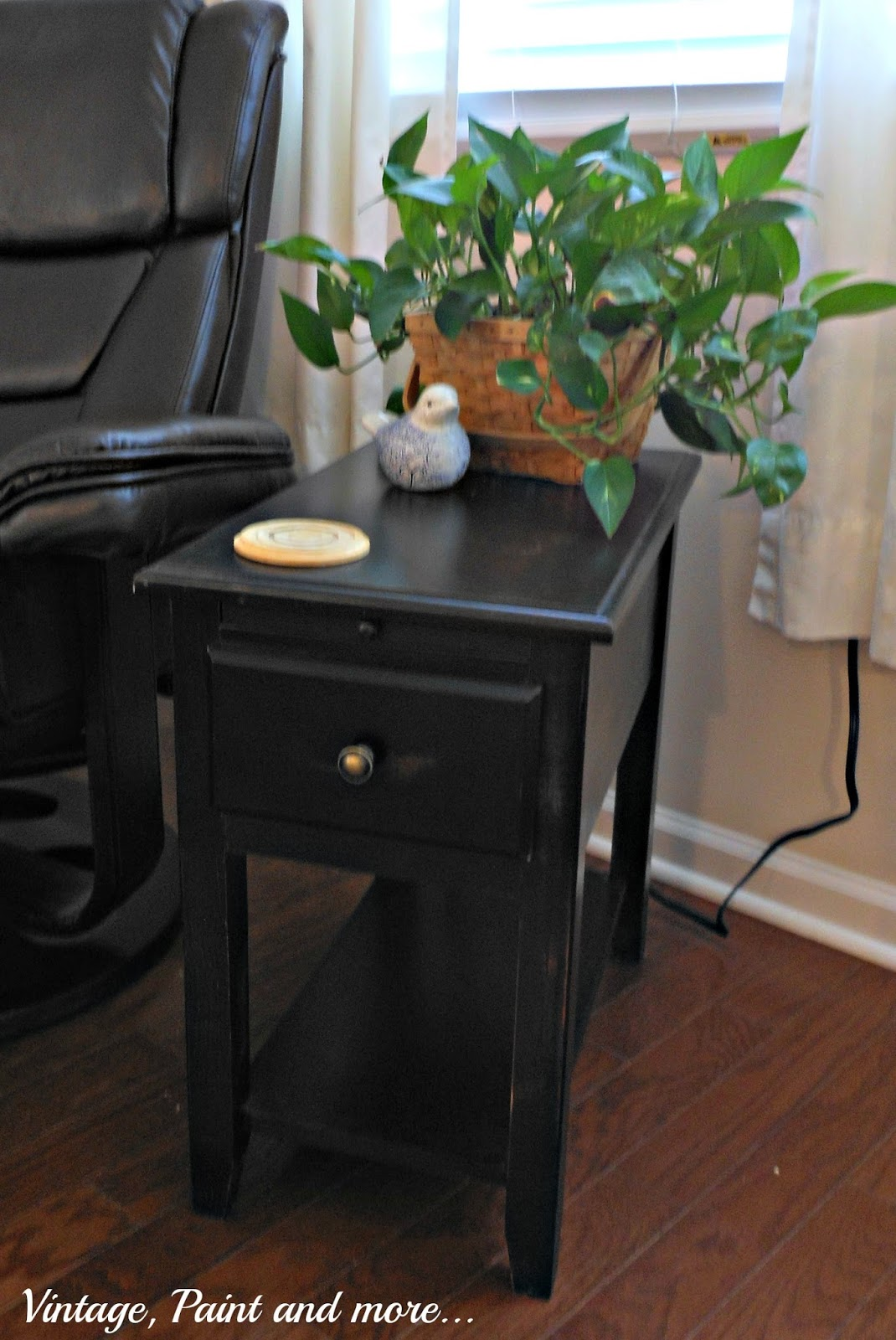 small dark wood side table slightly distressed with electrical outlets and USB ports for charging