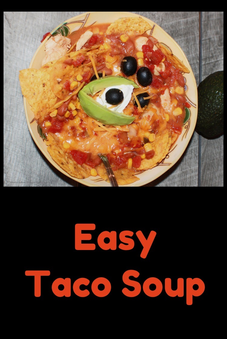 taco soup with corn, olives, tomatoes, sour cream and tortilla chips