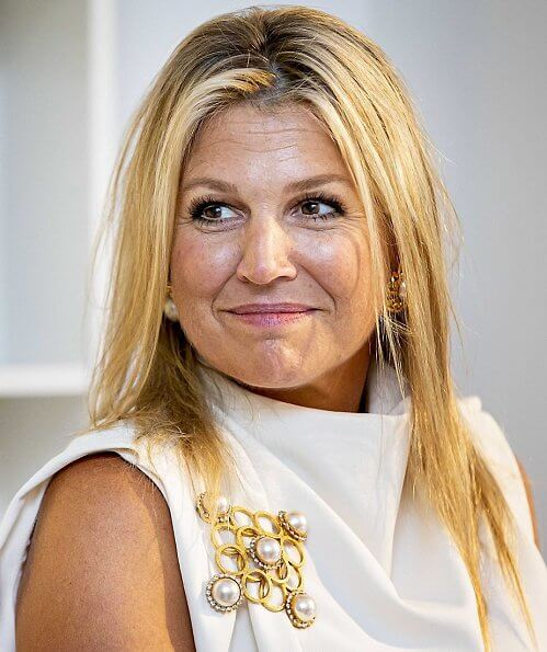 Queen Maxima wore Zara Sleeveless high-neck shirt. Maxima wore a sleeveless top by Zara. pearl earring and pearl brooch