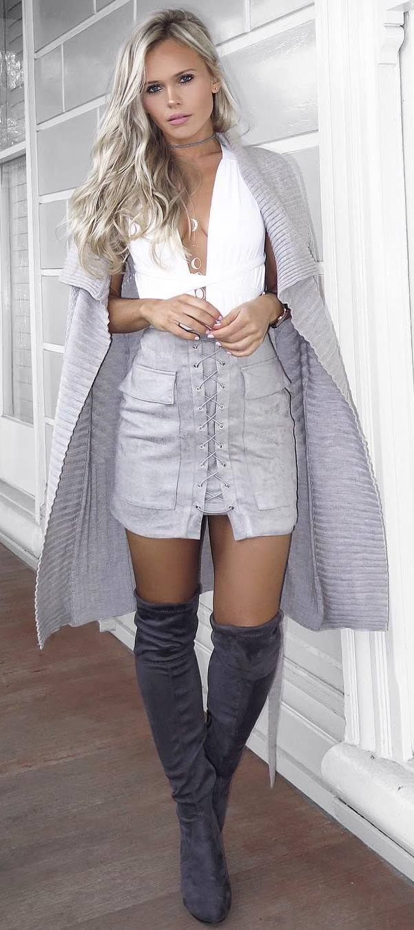 how to style a long cardigan : white top + lace up skirt + over the knee boots
