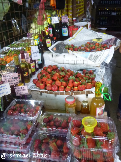 Fresh strawberries and fruit wines for sale in the pasaliubong shops of Strawberry Farm in La Trinidad, Benguet