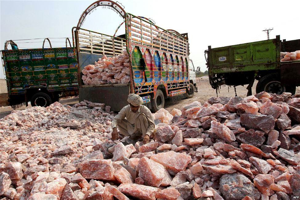 A worker collects salt stones for loading onto a truck outside the Khewra salt mines 5 Best Places To Discover In Pakistan
