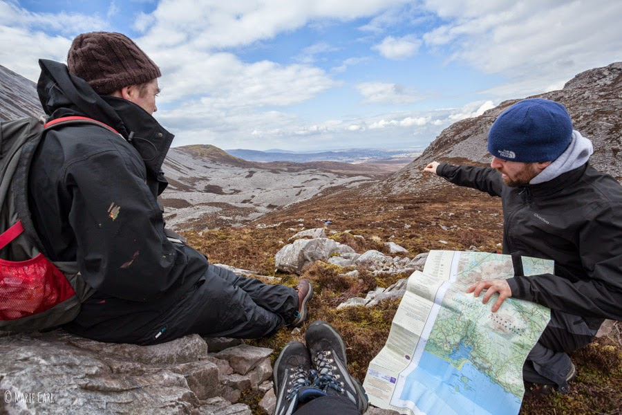 Two hikers with map deciding which way to go in Donegal mountains
