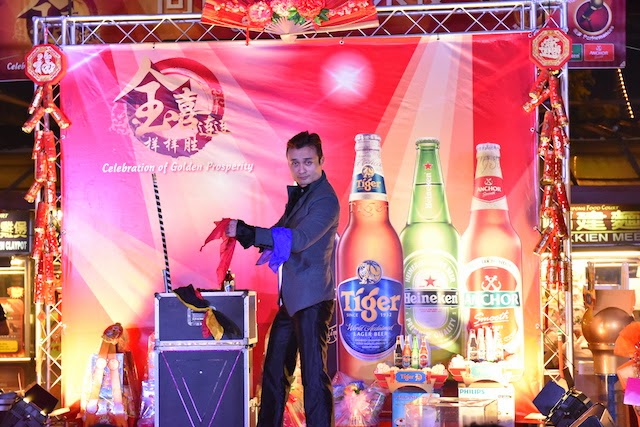 "Crowd entertained by illusionist during Tiger Beer's ""Celebration of Golden Prosperity"" on-ground event"