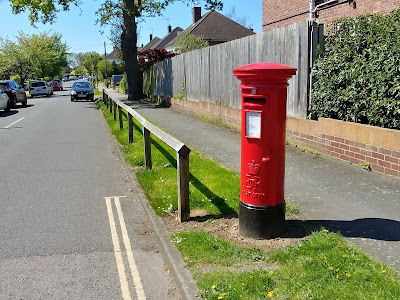 Photograph of ERII pillar box at the junction of The Gardens and Bluebridge Road, Brookmans Park Image from the North Mymms History Project released under Creative Commons