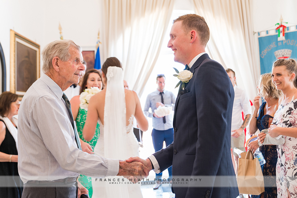 Grandfather of bride congratulating groom