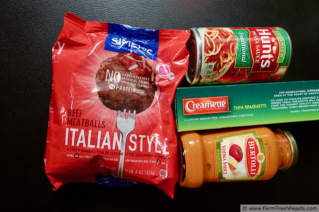 photo of the ingredients needed to make 2 batches of Instant Pot spaghetti and meatballs (meatballs, noodles, spaghetti sauce)