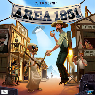 The cover art of Area 1851, showing an old west style town with a banner across the street that displays the title, and in the foreground, a cowboy hovering by means of a jetpack shakes hands with an alien holding a pickaxe.