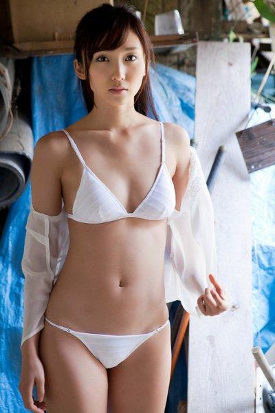 Nude girl using tampon