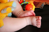 Baby feet. Stock Photo credit: sykicktb