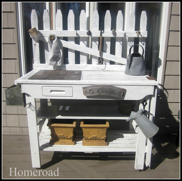 White potting bench built with picket fence pieces