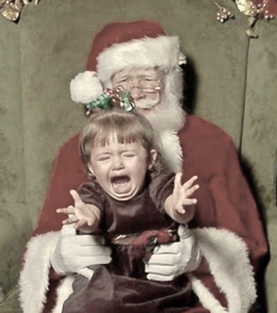 A sad little girl sitting on Santa's lap reaches for her mother. Santa looks very concerned.A Pleasant Christmas Story and other stories of Christmas Creepers. marchmatron.com
