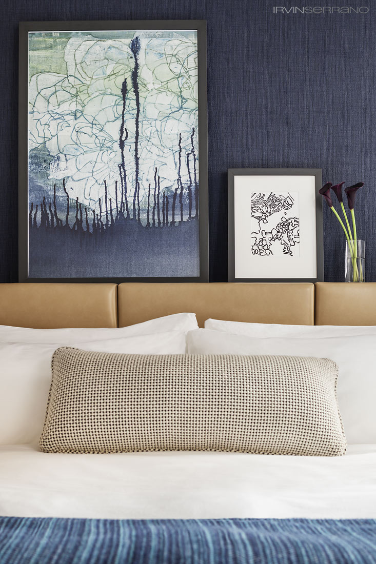Artwork leans against a woven wall created by artist Angela Adams for the Press Hotel.