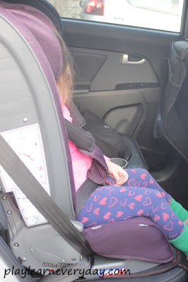 ivy sitting in the car seat