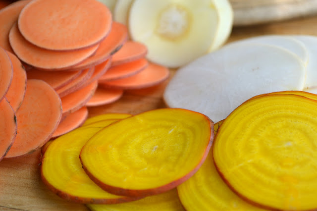 Thinly sliced root vegetables for homemade kettle chips