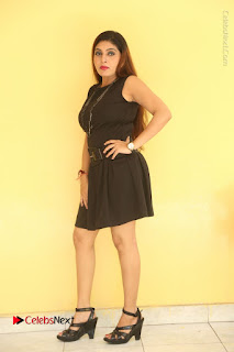 Tollywood Upcoming Actress Pooja Roshan Stills in Black Short Dress at Plus 1 Movie Trailer Launch  0238.JPG