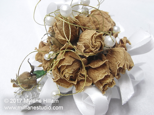Naturally dried flowers will lose all their colour in time. These roses were white when they were fresh.