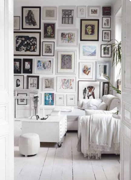 black and white picture and drowings framed in different thickness and shades of black and white gallery wall via belle vivir blog