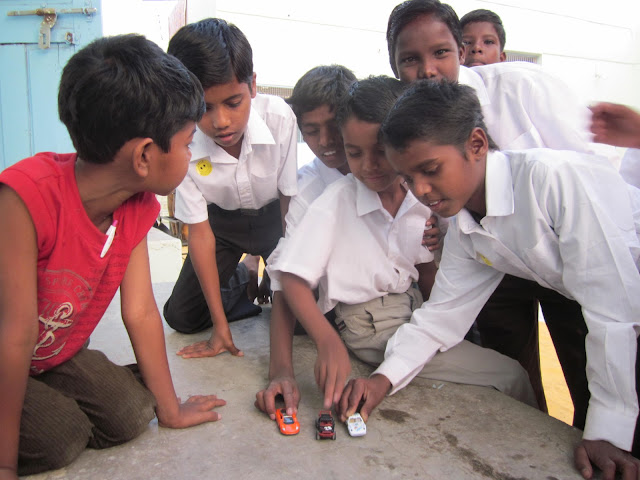 Children in India playing with toy cars