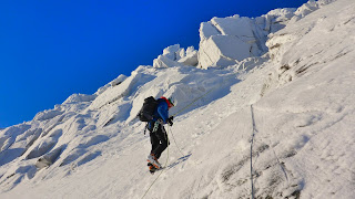 Dawn abseil for winter climbing on Cnap Coire na Spreidhe Cairngorms