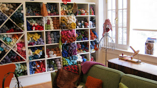 cubbies of yarn at Looped