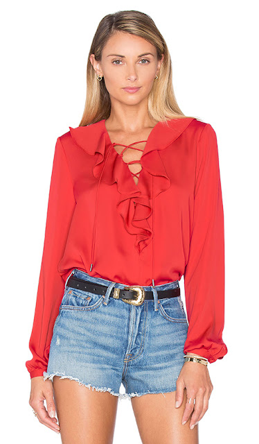 A Classic Red Boho Blouse with shorts
