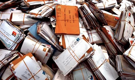 Half-ton of undelivered mail found in Italy postman's garage