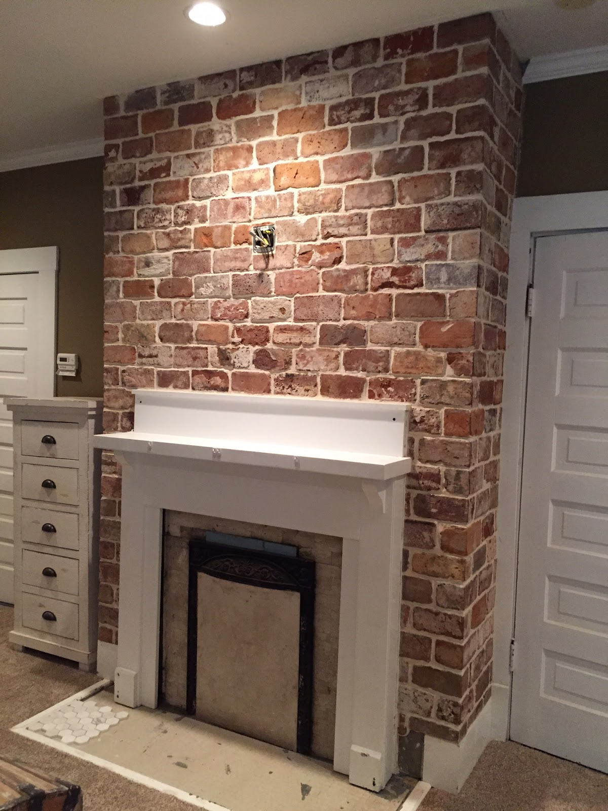 Reclaimed thin brick tiles fireplace www.vintagebricks.com