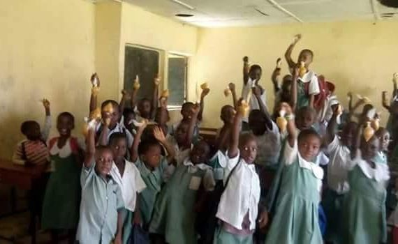 FG school feeding: Chai! Primary school pupils in Warri South display their 'meal' wrapped in nylon