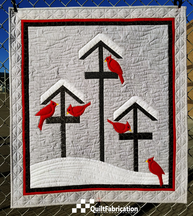 Winter Feed, a cardinal and winter quilt scene