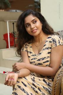 Telugu Actress Karunya Chowdary Stills in Short Dress at ATM Not Working Press Meet  0131.jpg