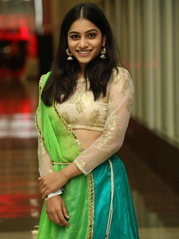 Tollywood Actress Punarnavi Stills In Green Langa Voni