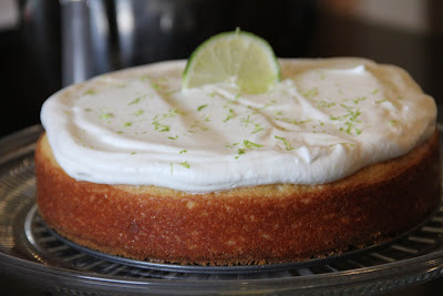 whole margarita cake topped with whipped cream and a slice of lime