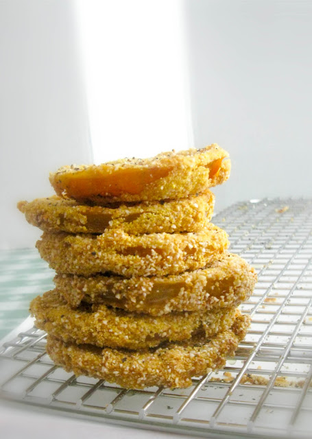 Fried Green Tomatoes, crispy on the outside tender and meaty on the inside.  Serve them as an easy appetizer or stack them for an elegant side dish.