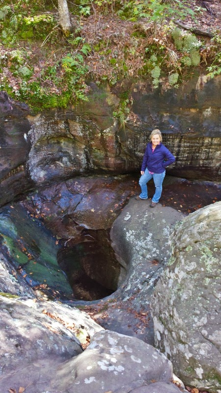 The Glory Hole Waterfall in Arkansas. A creek drilled hole straight through the top of a cave. The water falls from the caves roof to the floor.