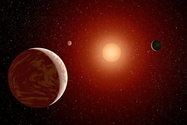 Hình ảnh đồ họa ngôi sao lùn đỏ Wolf 1061 cùng ba hành tinh quay xung quanh. Hình ảnh: NASA/JPL-Caltech.