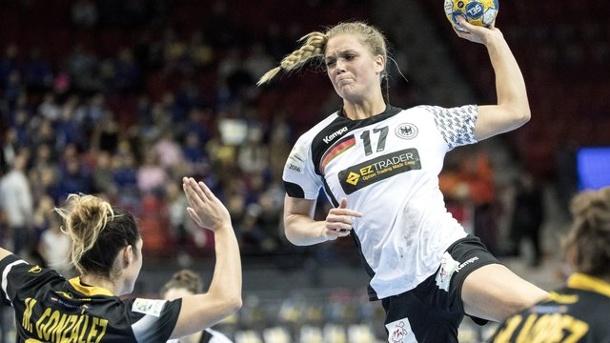 Anne Hubinger takes the goal. She scored five goals against Spain.