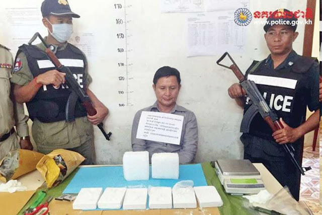 Lao national Kham Saiyavongsa is pictured with more than 4 kilograms of drugs with which he was apprehended during a cross-border sting operation in March. Photo supplied