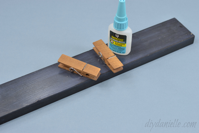 Use a good adhesive to glue the clips onto your wood.