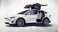 "The Model X has ""falcon-wing"" doors that open upwards (Credit: Tesla) Click to Enlarge."