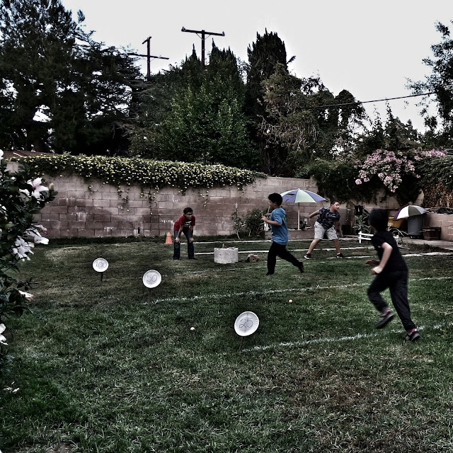 diy makeshift football yardage with paper plates and sticks