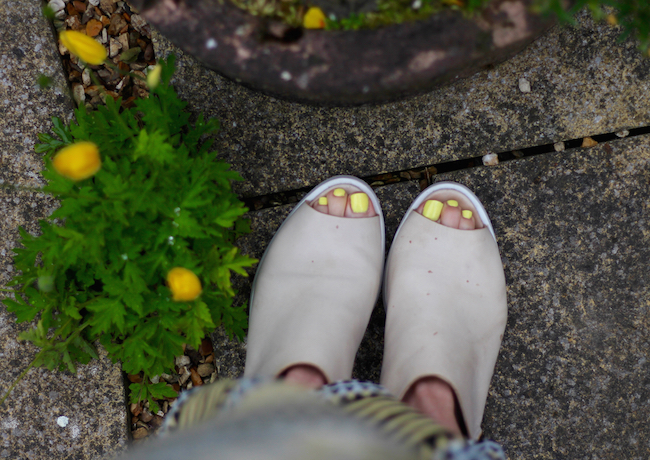 Fake Fabulous | Nude peep-toe booties and yellow nails