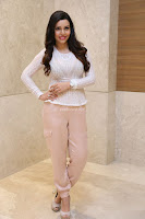 Kyra Dutt in Tight White Top Trousers at Paisa Vasool audio success meet ~  Exclusive Celebrities Galleries 004.JPG