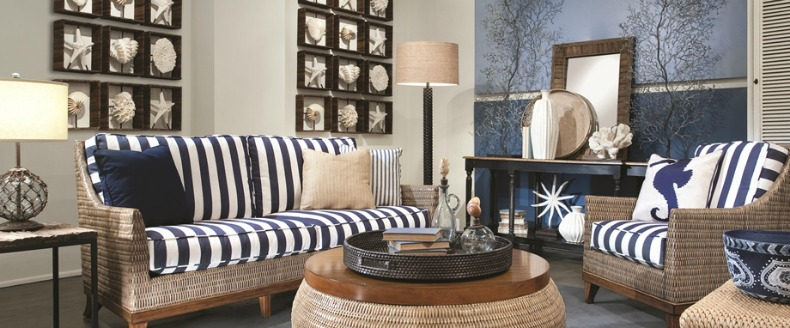 Coastal wicker chairs and ottmans in living room